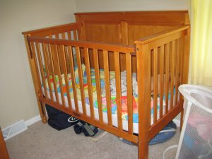 A crib is one of the things you need to buy when expecting a baby