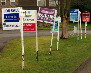 Since the house sold, we don't need these for-sale signs anymore