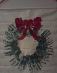 Let your kids make a Handprint Wreath this Christmas